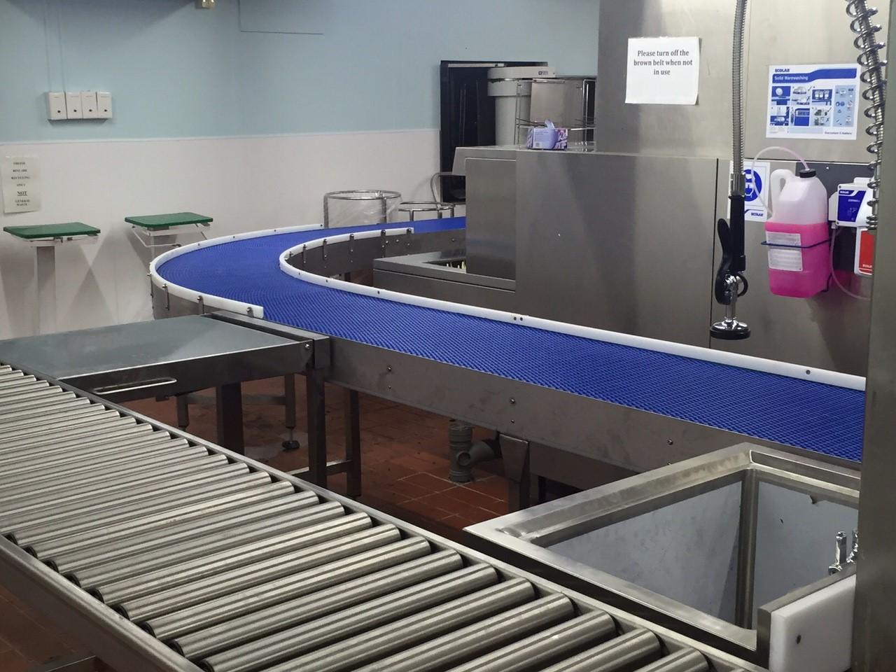 Modular belt conveyor, gravity roller conveyor, drop down tables and sink