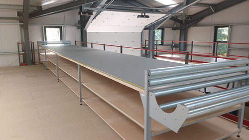 Fabric Cutting table complete with roll storage, layout length rollers and measure