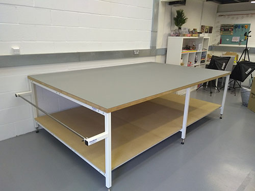 Fabric cutting table for small bespoke clothing company