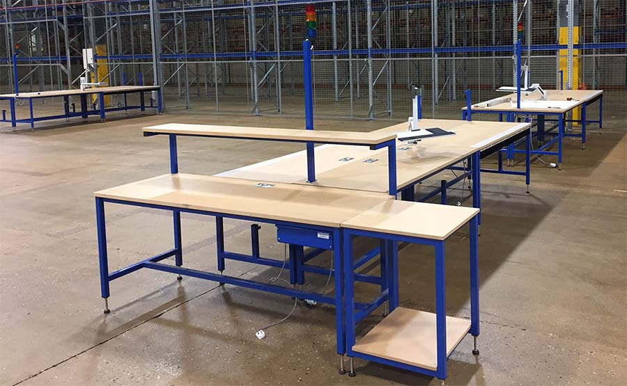 heavy duty Industrial workbenches with pre wired electricals, IT integration, Andon call, packaging material, cutting mats and ESD workcells