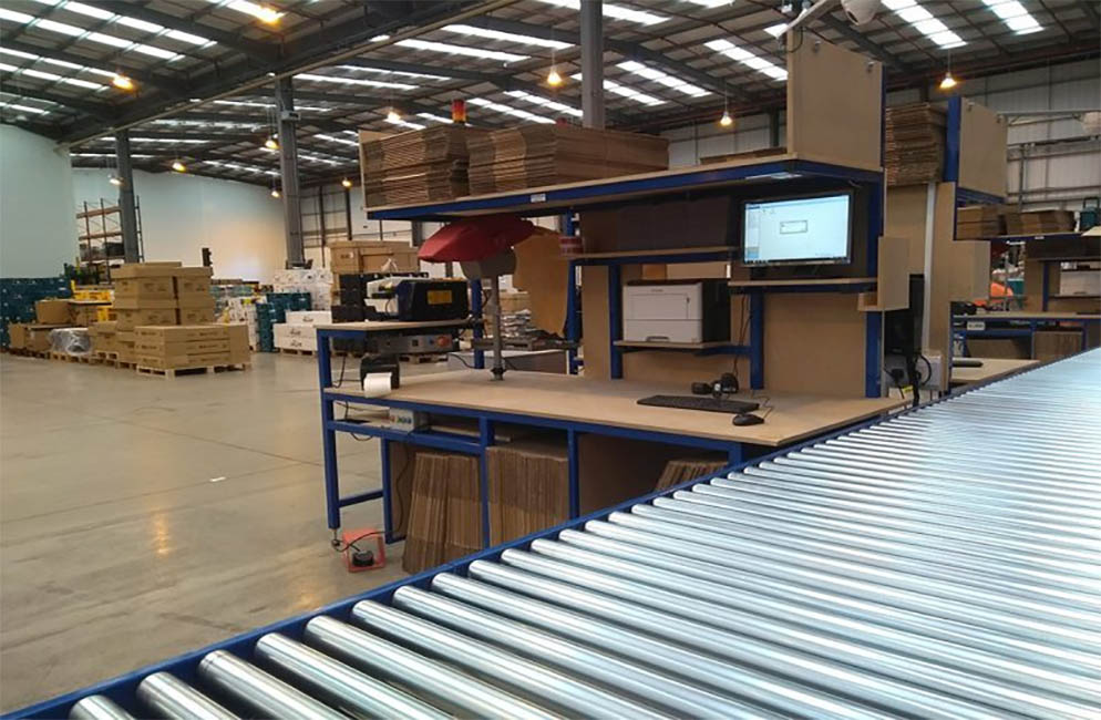 Bespoke workstation with driven roller conveyor