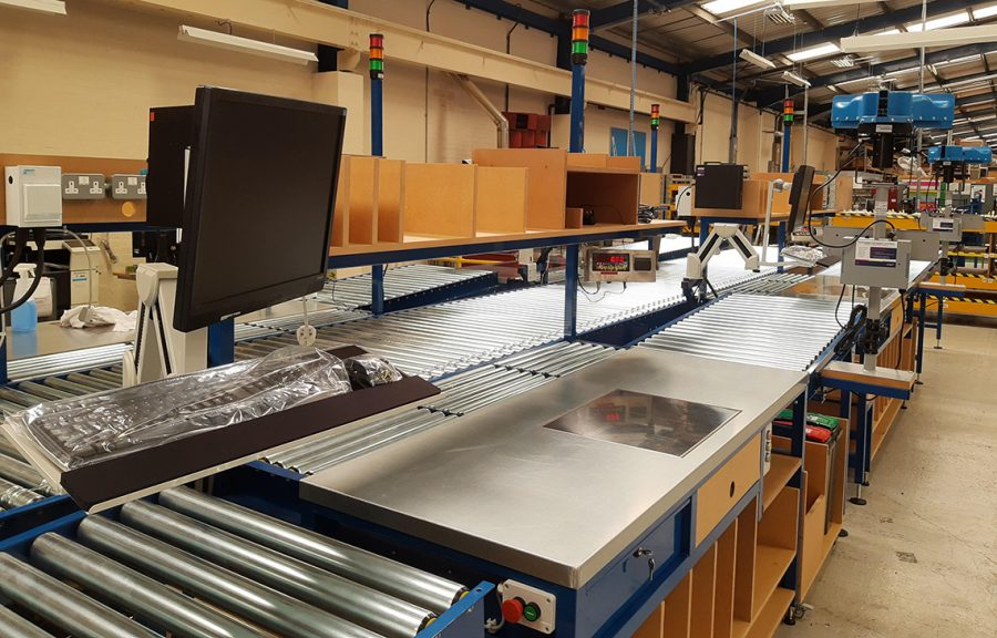Lean packing with powered roller conveyor take away