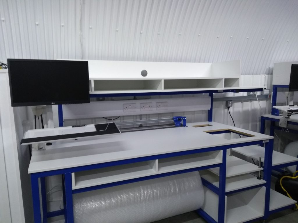 packing bench with roll holder and cutter