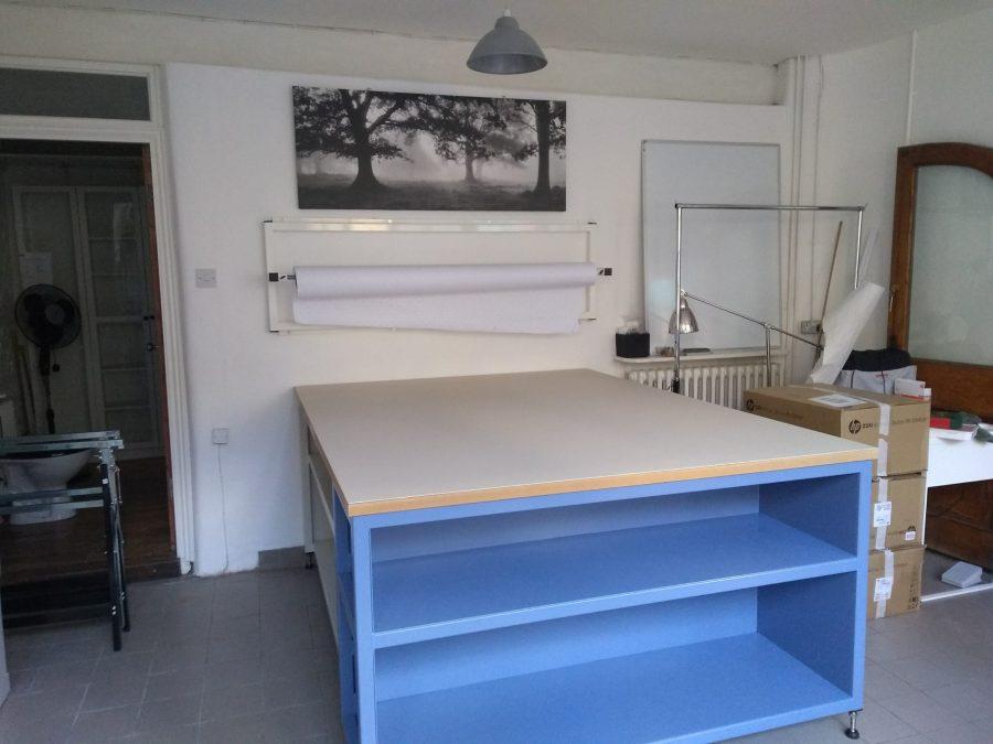 Cutting table with shelves
