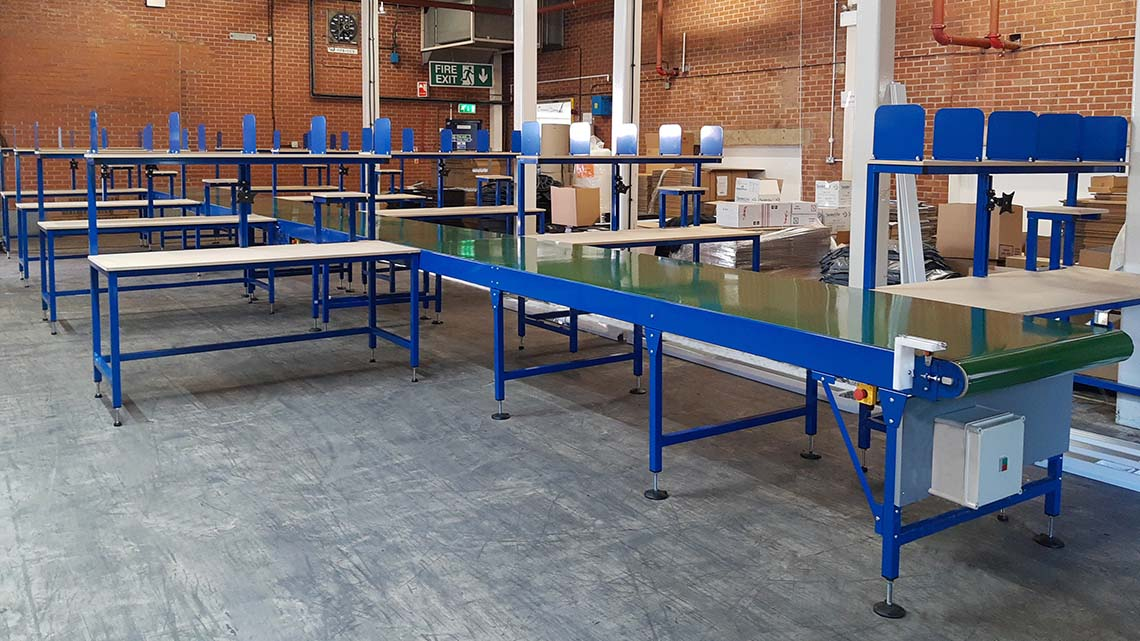 Conveyor with packing benches