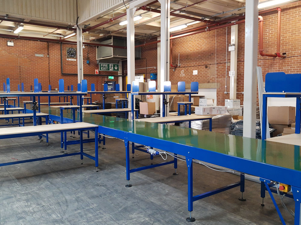 belt conveyor line with packing tables