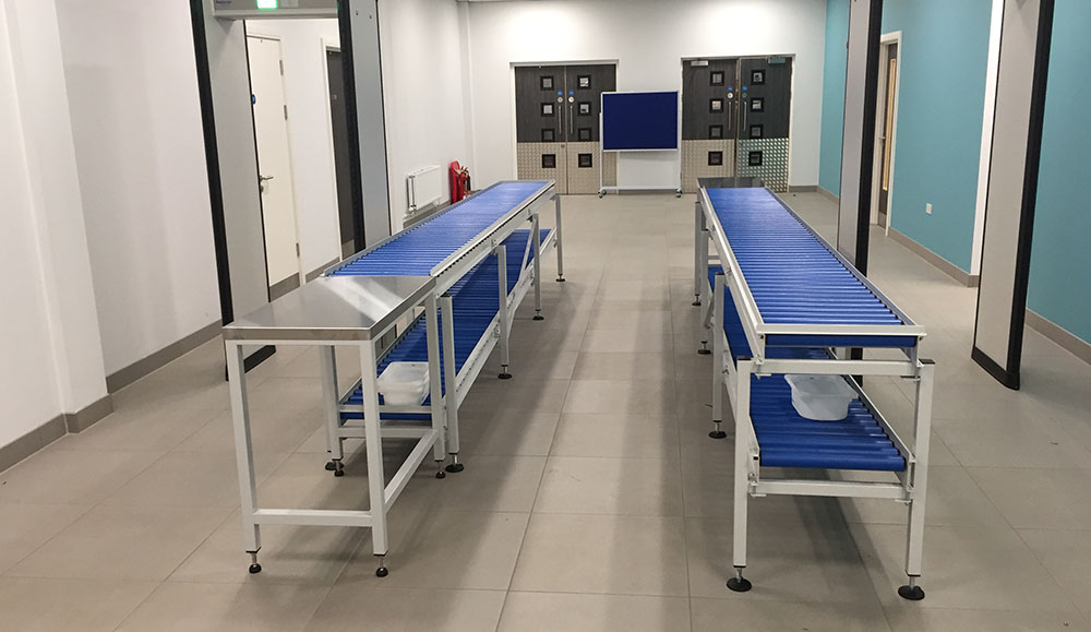 Two tier gravity conveyors for metal detector
