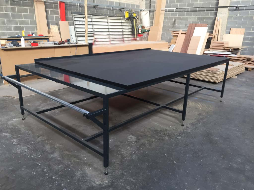 Black cutting table with roll holder