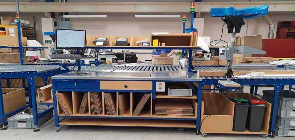 Bespoke designed and manufactured packing bench with roller conveyor system
