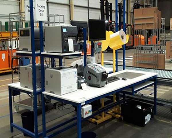 workbench with scales, IT packing aids and andon call system