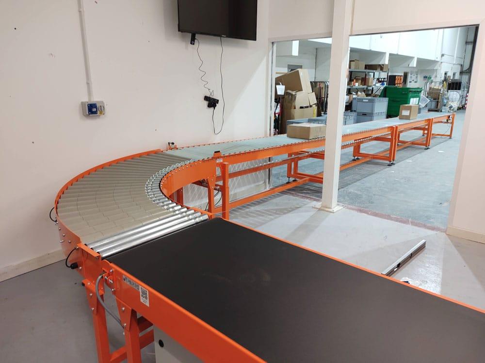 Orange conveyor system - belt to roller