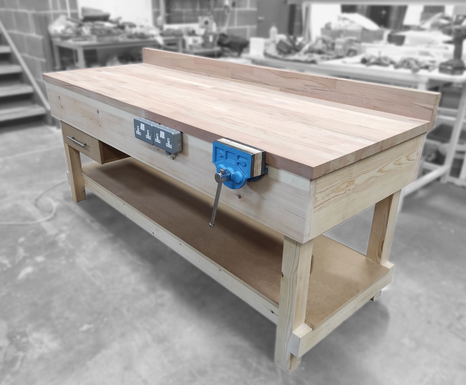 Wooden workbench with vice
