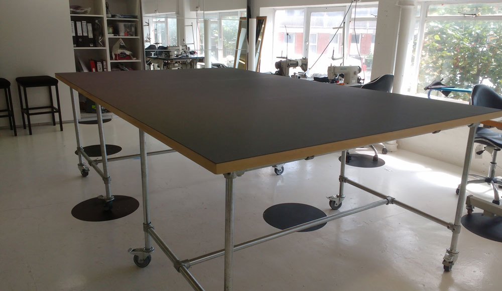 Key clamp frame cutting table